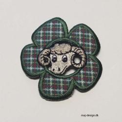 Ternet blomst m/en ged broderet strygemærke Ø 6 cm