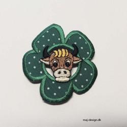 Prikket blomst med en ko broderet strygemærke Ø 6 cm