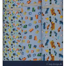 Tog, biler og tandhjul på lysblå bund Bomuld/lycra